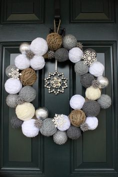 Snowball wreath using yarn-wrapped styrofoam balls, ornaments, and sweetgum balls.