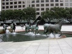 The Mustangs of Las Colinas is an Impressive horse sculpture fountain in Irving, Texas. It is the largest equestrian sculture in the world and it consists of nine mustangs running across a granite stream at Williams Square Plaza. Horse Sculpture, Modern Sculpture, Bronze Sculpture, Outdoor Sculpture, Water Sculpture, Photo Sculpture, Sculpture Garden, Performance Artistique, Running Horses