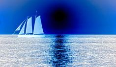 Taken from an original sunset photograph of a large sailboat. Several steps and hand applications were added to create this color negative creation in blue.