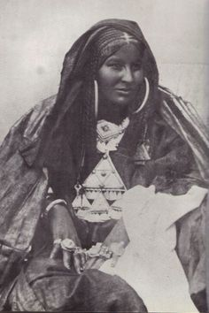 Portrait of the Tuareg poetess Dassine Oult Yemma (poems written in a special alphabet, the Tifinagh,   which is founded upon the ancient Libyan writing)wearing a characteristic Terouet pendant.  1885 - 1930. Hoggar, Algeria)