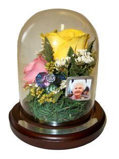 "Kay Mitchell said this upon picking up her floral encasement's, ""When I saw our beautiful memorials, I was so touched.  It makes you always feel that they are near.  Which they are!""  Thank you for your wonderful comments.  If you would like to learn where to get your flowers preserved or to find out how to become a dealer in your own town call (801) 227-0075."