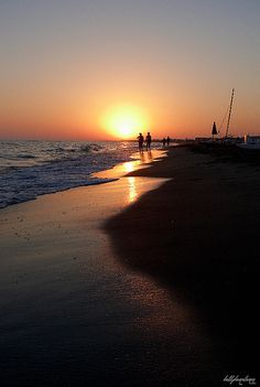 Sunset in Ostia Lido, Rome, Italy. Beach and beautiful boardwalk and cute, INEXPENSIVE restaurants all half an hour from Rome