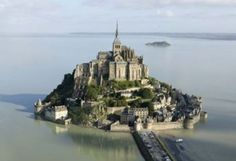 pic 2 High Tide!! amazing!!  This small medieval town, which is located on an island, it is the third most visited religious monument in France after Notre Dame and Sacre Coeur. abbey of Mont Saint Michel is a magical and unique in the world. When crossing the walls of the citadel, enters another time when it is possible to imagine the knights dressed in armor and peasants that moved supplies to the abbey.