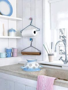 PAPER TOWEL HOLDER----I'd roll it the other way..but still...just might do this!