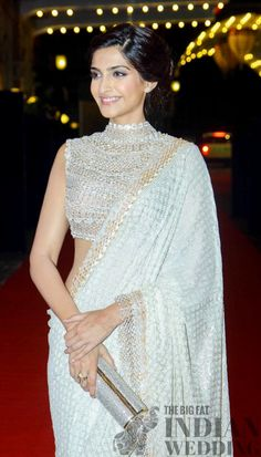 Sonam kapoor wearing white Saree at Ahana Deol's wedding- fashionista - love how she updo the blouse with shimmers n crystals ..