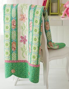 This nature-inspired quilt pattern featured in Love of Quilting September/October is a throw size quilt featuring appliqué and and pieced rows. Quilt by Amanda Murphy.