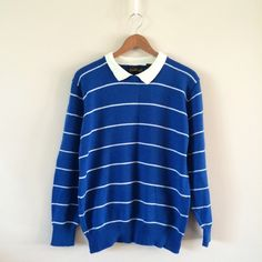Vintage Collared Pullover Sweater Adorable little pullover sweater with collar. Royal blue and white stripe. Great condition!  BRAND: Measure Up MATERIAL: 100% acrylic YEAR/ERA: late 70s LABEL SIZE: 40 BEST FIT: S  MEASUREMENTS: Bust 23 inches Length 25 inches See Closet Guide & Size Guide posts for more info.  Check out my closet for more vintage!  Vintage Sweaters
