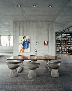 great clash of raw concrete and chique vintage chairs