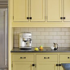oil-rubbed bronze hardware installed as part of this remodeled period look kitchen