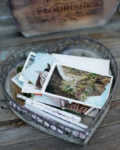 A collection of postcards pictured places special to the couple. In lieu of a guestbook, well-wishers wrote their sentiments on the cards. Note by note, the maid of honor will mail them to the couple throughout their first year of marriage.