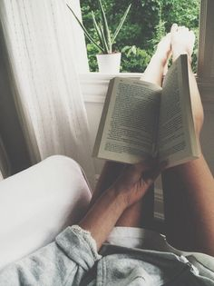 I am a book lover and this photo pretty much sums up what I would cherish doing on a Sunday afternoon, stretching out, reading a novel and watching the summer sun set!