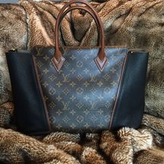 Louis Vuitton W PM Tote Monogram and Noir (Black) BRAND NEW sought after W Tote PM in brown signature Louis Vuitton monogram and black. This bag was used ONCE and has price tag; receipt and dust bag included.  MUST HAVE! I have the original receipt! Purchased at the Rodeo Drive LV Store! Louis Vuitton Bags Shoulder Bags