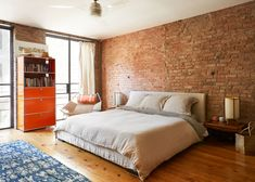 bedroom with exposed brick wall and orange cabinet Exposed Brick Bedroom, Brick Wall Bedroom, Brick Wall Decor, Orange Cabinets, Freedom House, Orange Brick, Bedroom Orange, Wood Staircase, Brick And Wood