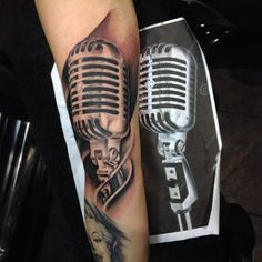 What does microphone tattoo mean? We have microphone tattoo ideas, designs, symbolism and we explain the meaning behind the tattoo. Mic Tattoo, Microphone Tattoo, Zeus Tattoo, Key Tattoos, Unique Tattoos, Cool Tattoos, Tattoo Art, Music Tattoo Sleeves, Sleeve Tattoos