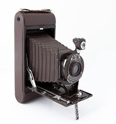 "The No. 1A Pocket Kodak was a folding camera with a pull out bed. It makes 2½×4¼"" size exposures on type 116 film rolls. It was available in an ""Autographic"" version. It was manufactured from 1926 to 1932. From 1929-1932 it was available in the US in four colors: blue, grey, green and brown."