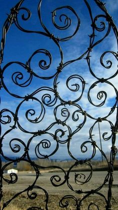Barbwire arch for your garden/yard  Wow! We could do this!
