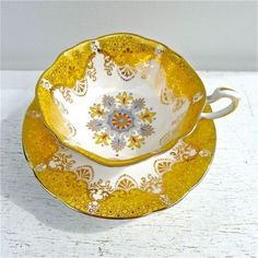 Beautiful yellow and white, with a touch of dove-grey tea cup and saucer.