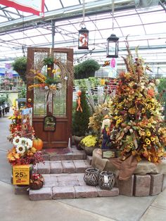 Create a fall holiday tree for your front entrance or porch with silk flowers from Stauffers of Kissel Hill Garden Centers. www.skh.com.