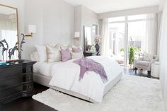 Suzie: Carlyle Designs - Pastel bedroom with soft gray walls paint color, gray swoop arm chair ...