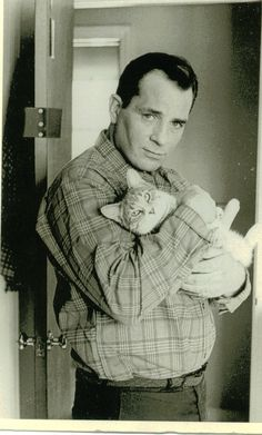 Jack Kerouac with a cat. 1965 photo by Jerry Bauer.  A man is not all bad who loves a cat.