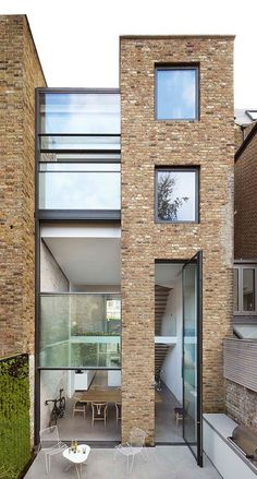 Extra-tall windows connect Studio Octopi's Slot House with its patio garden Architecture Design, Contemporary Architecture, Residential Architecture, Casa Farnsworth, High Windows, London House, House Extensions, Design Moderne, Victorian Homes