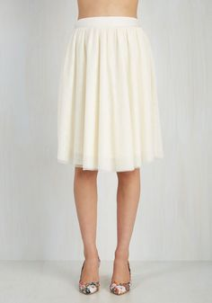 Tulle of the Trade Skirt in Blanc. This staple-worthy tulle skirt is your secret weapon to finishing an enviable look with a feminine touch! #cream #wedding #modcloth