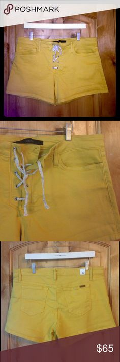 "JOE'S JEANS Mustard Lace-Up Denim Shorts NWOT 32 JOE'S JEANS Mustard Lace-Up Denim Shorts NWOT 32 •DETAILS: *5-Pocket Styling.  *Belt Loops on Waistband.  *Lace-Up Fly with Concealed Button Closure.  *NWOT! IMO, they appear to have been tried on.  *Last Pic is a stock photo of these Joe's Jeans shorts in a different color.  •MEASUREMENTS: Waist is 36"" - 38""; Length is 12"" - 14""; Rise- 9.5""; Inseam- 4""  •MATERIAL: 93% Cotton, 6% Polyester, 1% Lycra •CARE: Machine Wash Cold **SMOKE-FREE…"