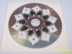 Een van mijn eerste geborduurde cd,met prachtig Madeira glansgaren.