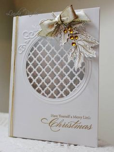 handmade Christmas card ... white with gold accents ... circle with die cut trellis .. stamped bough of holly ... gold embossed sentiment ... gold cords ... beautiful!!