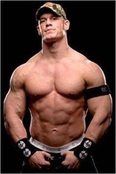 """John Cena of the WWE, is an incredibly well built wrestler. At 6'1"""" tall and 245lbs, Cena has some giant arms. The Champ was a competitive bodybuilder..."""