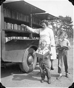 Old Bookmobiles - libraries These children are in for a treat with their books.