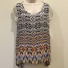 New Direction top abstract chevron with lace Top in striking pattern with lace trim.  Made of a lite weight material, comfortable for summer heat.  Measures 19 inches across front, from armpit to armpit.  New with tag. New Direction Tops Blouses