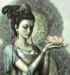 Quan Yin Perfume Oil by LunaAndEvesBoutique. Sweet, strong and lovely. This alluring fragrance has notes of Rose Otto, Ylang Ylang, Jasmine, Woods, Spice, Citrus and a secret blend of essential oils.