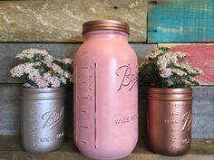 Set of three mason jar #vases in #coral, copper, and light bronze. There is one 1/2 gallon jar and two pint size jars. You can choose this color scheme or choose your own. Th... #gifts #rustic #distressed #metallic
