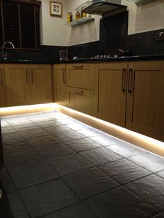Led strip lighting in kitchen.