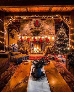 in a Cabin with a warm, cozy fireplace.Christmas in a Cabin with a warm, cozy fireplace. Why do we work so hard to make getting home simple? 🤔 Because it's where we eat together, of course! Cozy Christmas, Rustic Christmas, Christmas Fireplace, Christmas Stockings, Cabin Christmas Decor, Cottage Christmas, Christmas Decorations For The Home Living Rooms, Christmas Trees, Christmas Lights
