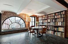 Quiet contemplation: The arched window in the library provides views out over trendy SoHo...