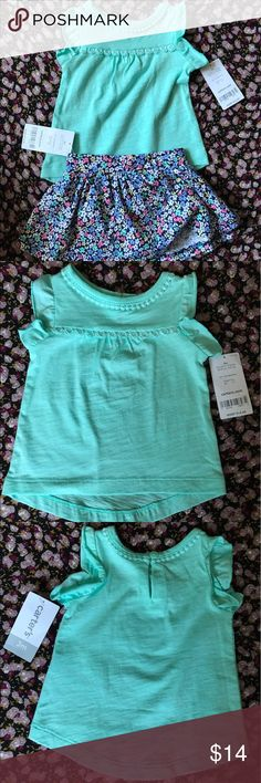 Carter's girls ruffled tank and floral skirt 3M New with tags infant girls 3 month old ruffled aquamarine tank top with floral skirt. Skirt has built in shorts. Shirt has simple lace detailing. Perfect summer outfit, light and breezy. 100% cotton. Carter's Matching Sets