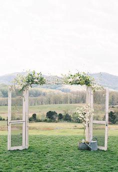 Shabby-chic doors, vintage wedding arbor, white florals // Adam Barnes Fine Art Photography