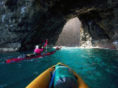 Google Image Result for http://imgc.allpostersimages.com/images/P-473-488-90/64/6420/Z8M9100Z/posters/douglas-peebles-kayaking-sea-arch-napali-coast-kauai-hawaii-usa.jpg