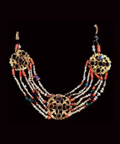 Middle East | Necklace / pectoral; gold medallions set with glass cabochons, connected with five rows of baroque pearls and coral beads. | Horsehead hallmark, ca 1838 | 1'500€ ~ sold (June '13)