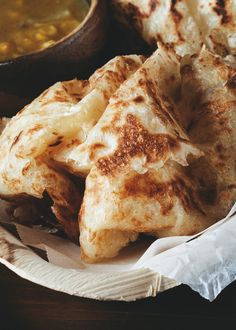 Get this at Mamak Asian Street Food. in Orlando Roti Canai (Indian flatbread) (A Table For Two) Indian Food Recipes, Asian Recipes, Curry Recipes, Dhal Recipe, Roti Canai Recipe, Roti Bread, Indian Flat Bread, Indian Breads, Asian Street Food
