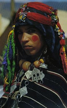 A Berber girl in Moroco - they usually decorate their face with tatoos