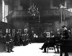 Chelsea Pensioners relax in a communal room in 1923