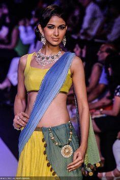 A model showcases a creation by Dipti Amisha during the India International Jewellery Week (IIJW), held at Grand Hyatt, Mumbai, on August 06, 2013.