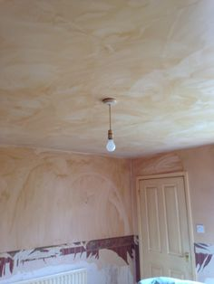 Cleaned nicotine stained ceiling by spraying with ...