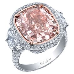 Neil Lane natural pink colored cushion shape diamond ring set in platinum.... Pretty Engagement Ring