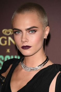 Never one to disappoint, Delevingne chose a dark berry lip, subtle highlight and emphasised her brows while walking the red carpet.
