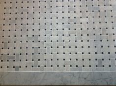 Not crazy about this - Our new bathroom floor - carrara marble with granite accents in a traditional basketweave pattern