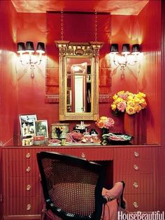 Create a glamorous dressing room out of your walk-in closet. Designed by Mary McDonald. housebeautiful.com #vanity #closets #sconces #wardrobe